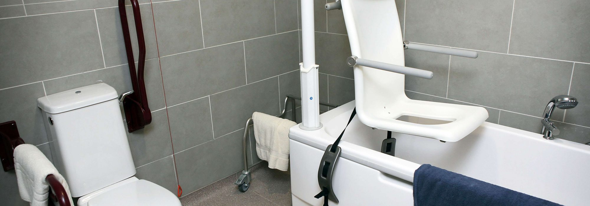 A bathroom that has been adapted to allow accessibility to the bath and toilet
