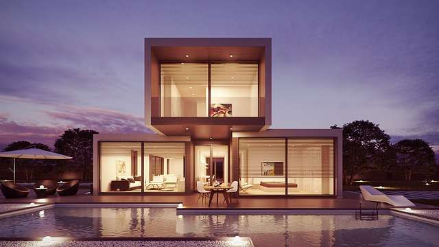 A modern house with a pool in front of it