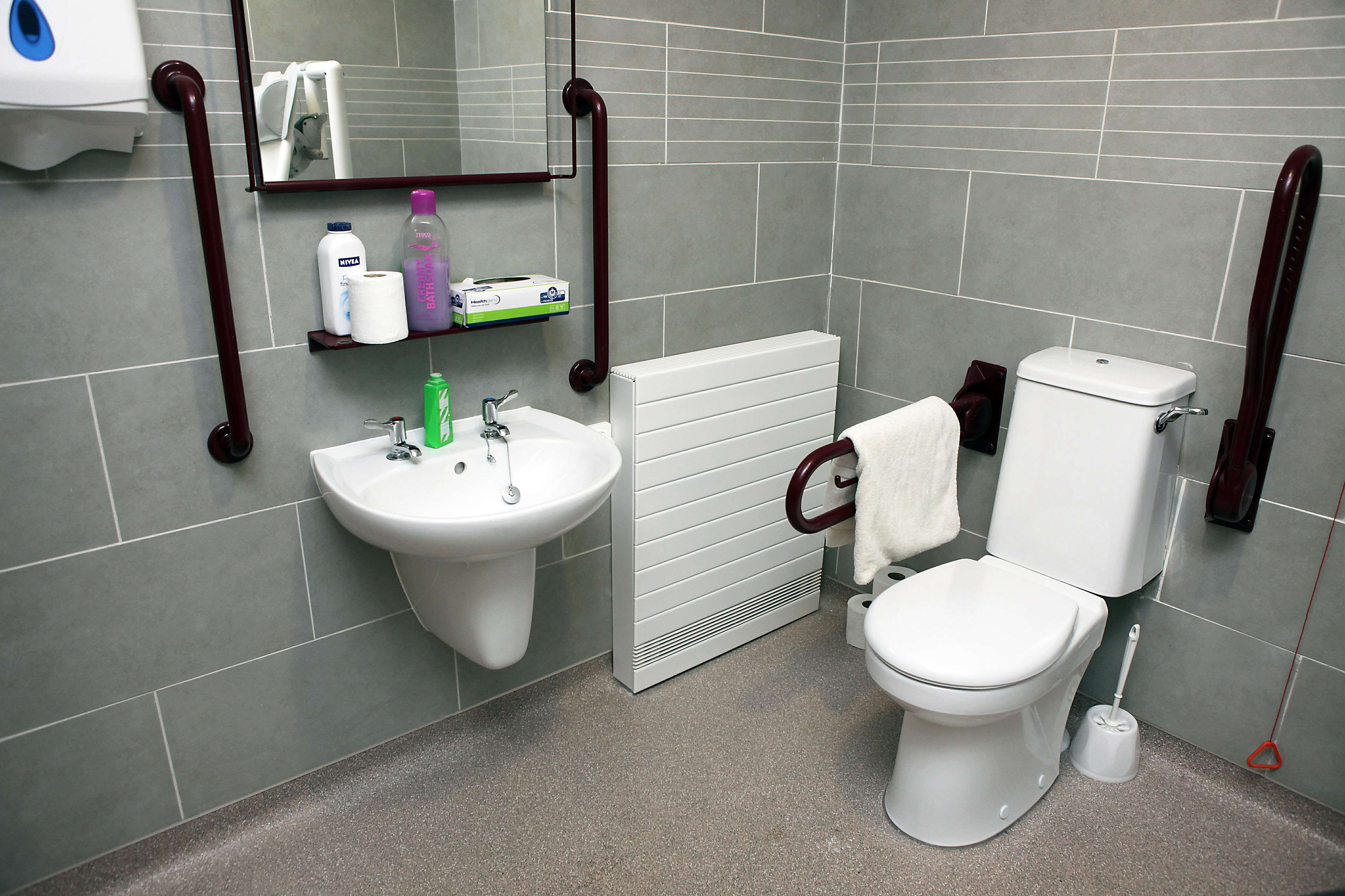 A bathroom adaption with handrails at Tithebarn Residential Home, Great Crosby.