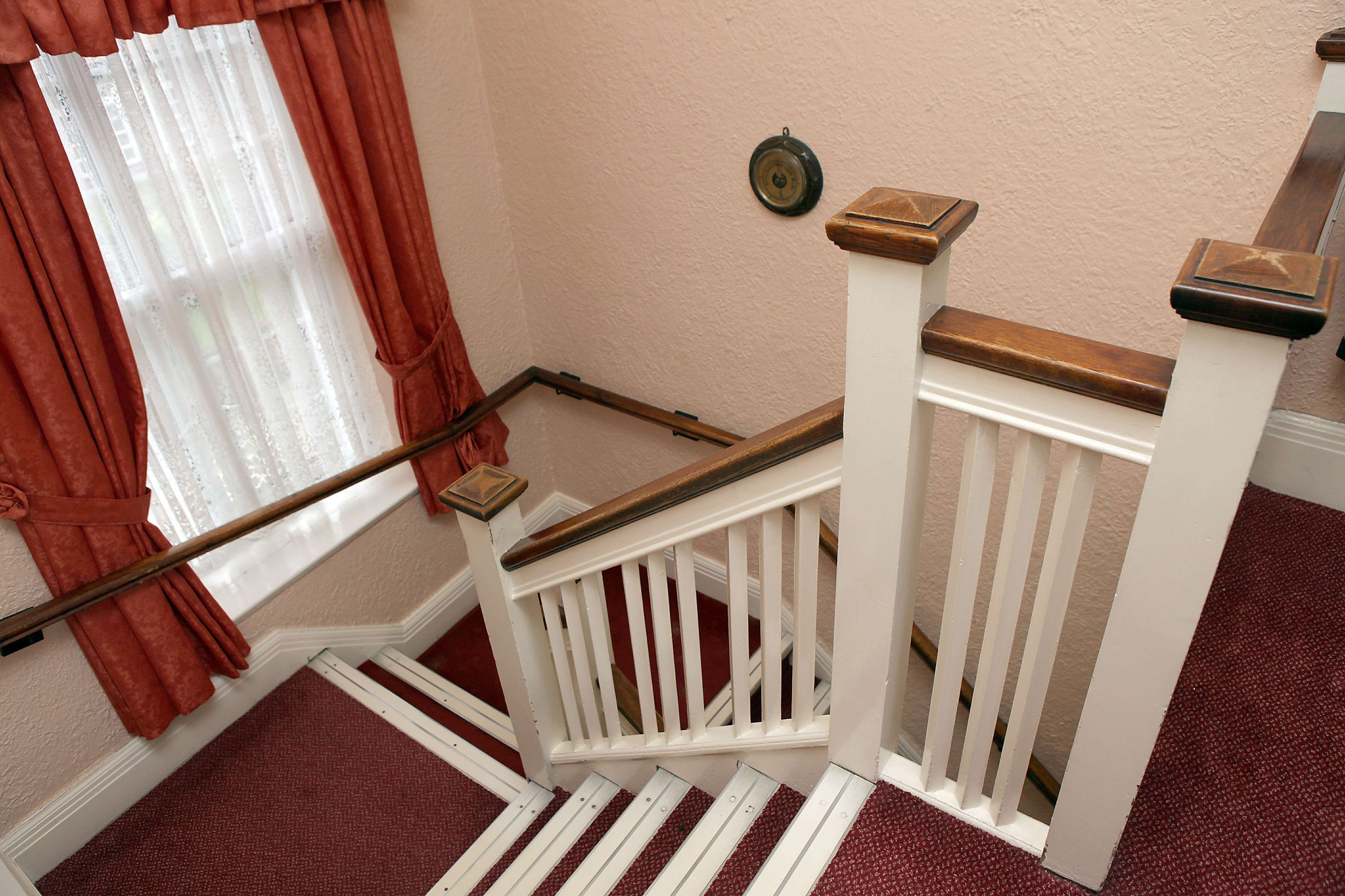 Stairwell adaption with wooden handrails at Tithebarn Residential Home, Great Crosby.