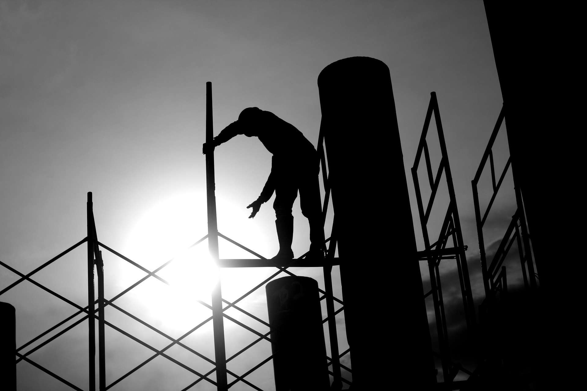 Silhouette of a Flanagan builder on scaffolding